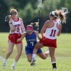 DAVID LE/Staff photo. Danvers senior Anne Tarricone (7) loses the ball while being sandwiched between Masco sophomore Jordyn Tveter (5) and senior captain Molly Gillespie (11) during the first half of play. The Falcons fell 15-8 to the Chieftans in the D1 North quarterfinals on Thursday afternoon. 6/2/16.