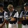 DAVID LE/Staff photo. Danvers sophomores Mathieu Reidy, left, and Zach Dillon, right, with junior Matt Andreas, can't bear to watch Dighton-Rehoboth celebrate their D2 State Championship following a 1-0 win on Wednesday evening. 6/15/16.