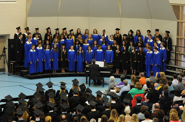 PAUL BILODEAU/Staff photo. The choir performs during Ipswich High School's graduation ceremony in the field house at the school.