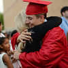 PAUL BILODEAU/Staff photo. Joanne Pinkham hugs her grandson, Devin Pinkham, at the end of Salem High School's graduation ceremony in the high school's field house.