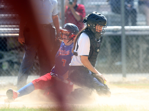 DAVID LE/Staff photo. Swampscott senior captain Olivia Cook can't corral a throw to home as Tewksbury junior Teagan Trant (7) slides safely into home. 6/12/16.