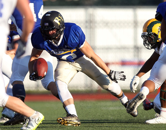 DAVID LE/Staff photo. Bishop Fenwick's Cody Mullen darts through an opening against the South in the 55th Agganis Football Game. 6/30/16.