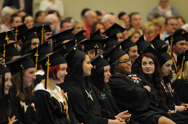 PAUL BILODEAU/Staff photo. Students listen as the graduates name are read for scholarships during Ipswich High School's graduation ceremony in the field house at the school.