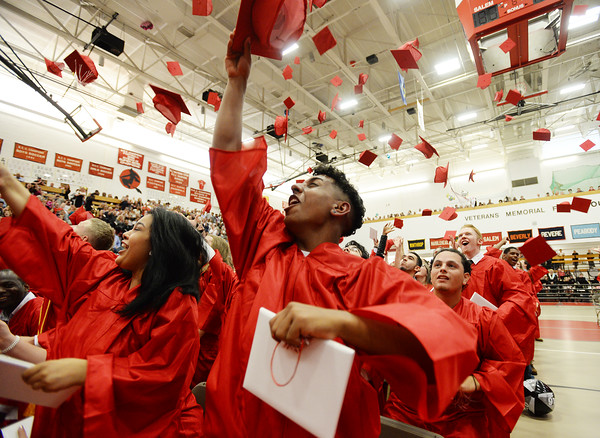 PAUL BILODEAU/Staff photo. The class of 2016 throw their hats in the air during Salem High School's graduation ceremony in the high school's field house.