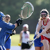 DAVID LE/Staff photo. Masco freshman midfielder Marissa DeLucia (15) fires a goal past the outstretched stick of Danvers sophomore goalie Riley Geannaris, left. 6/2/16.