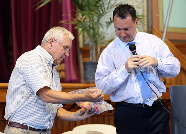 DAVID LE/Staff photo. Former Peabody Mayor Michael Bonfanti, left, helps current Peabody Mayor Ted Bettencourt, open items in a time capsule from 1989 inside Peabody City Hall on Wednesday afternoon. 6/29/16.