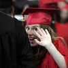 KEN YUSZKUS/Staff photo.   Meghan Clough sneaks a wave to the audiance as the Marblehead High School graduates proceed to their chairs in the field house.     06/12/16