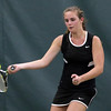 DAVID LE/Staff photo. Marblehead third singles player Julia Channing concentrates on returning a serve against Concord-Carlisle's Caroline Zeng on Wednesday afternoon. 6/8/16.