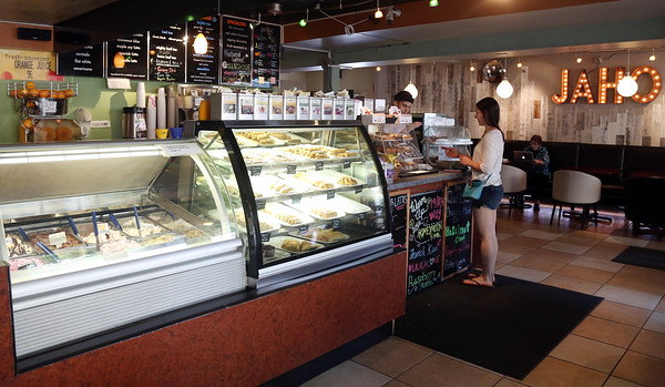 DAVID LE/Staff photo. The inside of Jaho Coffee and Tea located on Derby Street in Downtown Salem. Pasty and gelato cases sit next to the front counter. 6/23/16.