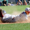 KEN YUSZKUS/Staff photo.     Danvers' Danny Lynch safely steals 2nd as Belmont's Kevin Dacey tried to tag him during the Belmont vs Danvers Division 2 North quarterfinal baseball playoff game.     06/06/16