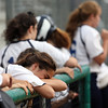DAVID LE/Staff photo. A Swampscott player buries her face in her arms after the Big Blue fell 7-0 to Tewksbury in the D2 North Final at Martin Field in Lowell. 6/12/16.