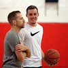 "DAVID LE/Staff photo. Portland Trailblazers rookie guard Pat Connaughton, right, smiles while talking with Mike Crotty, of the Middlesex Magic AAU Basketball program, during Connaughton's ""With Us"" basketball camp. 6/28/16."