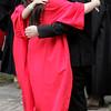 KEN YUSZKUS/Staff photo.   Marblehead High School math teacher Wayne Dutch is hugged by graduate Mia Griffin outside the school before the ceremony.     06/12/16