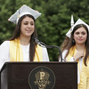 KEN YUSZKUS/Staff photo.   Peabody Veterans Memorial High School 2016 co-presidents Marina DeMild, left, and Josephine Pagliuca give the welcome speech at their graduation.       06/03/16