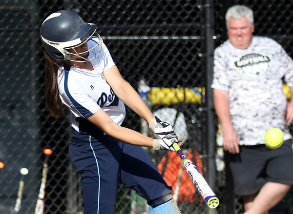 DAVID LE/Staff photo. Peabody's Tianna Dawe launches the first of back-to-back homers for the Tanners against Beverly. 5/25/16.
