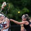 DAVID LE/Staff photo. Marblehead junior Lucie Poulin (5) loses control of the ball while getting fouled by Ipswich sophomore Meghan O'Connor (12). 6/9/16.