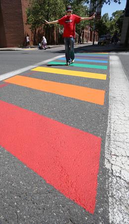 KEN YUSZKUS/Staff photo.    Denis Castleton of Salem walks in the newly painted rainbow crosswalk across Washington Street in Salem.      06/17/16