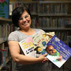 DAVID LE/Staff photo. Katia Pascoal is a Children's Librarian at Peabody Institute Library in Peabody and every month she holds a bilingual story time, reading Portuguese and English children's books. 6/20/16.