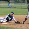KEN YUSZKUS/Staff photo.     Danvers' Matt Andreas slides safely into third base during the Belmont vs Danvers Division 2 North quarterfinal baseball playoff game.     06/06/16