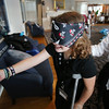 KEN YUSZKUS/Staff photo.  Charlotte Doherty, 10, of Boston, left, is blindfolded for the game Pin the Patch On the Pirate which is based on Pin the Tail on the Donkey game.  Volunteer Janet Todaro ran the game. The activity happened at the Sailing Heals Pirates and Princesses Treasure Hunt Adventure held at the Boston Yacht Club in Marblehead.     06/29/16