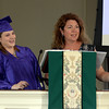 RYAN HUTTON/ Staff photo<br /> Northshore Recovery High School graduate Elizabeth Boggs laughs at a joke from school director Michelle Lipinski before giving her graduation speech at the school's commencement ceremony at the Second Congregational Church in Beverly on Wednesday night.