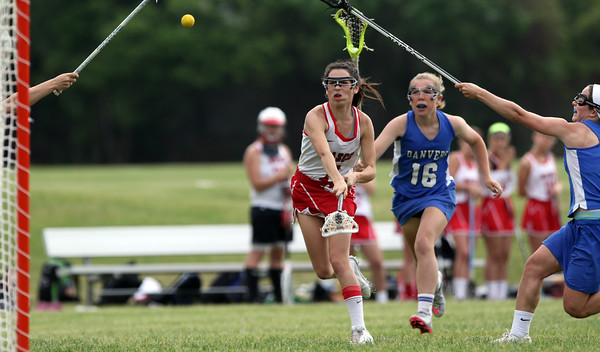 DAVID LE/Staff photo. Masco junior Kaitlyn Waystack (7) takes a shot on net on a free position shot against Danvers on Thursday afternoon. 6/2/16.