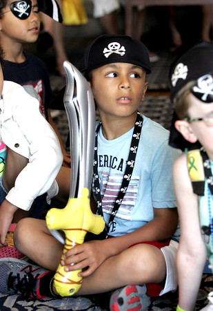 KEN YUSZKUS/Staff photo.   Zayd Benayoud, 7, of North Andover, watches The Comedy Magic of Dondo during the Sailing Heals Pirates and Princesses Treasure Hunt Adventure held at the Boston Yacht Club in Marblehead.     06/29/16