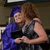 RYAN HUTTON/ Staff photo<br /> Northshore Recovery High School graduate Julia Durbeck gets a kiss on the cheek as well as a diploma from school director Michelle Lipinski at the school's commencement ceremony at the Second Congregational Church in Beverly on Wednesday night.