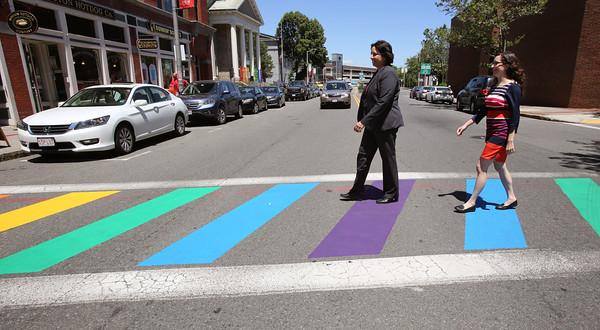 KEN YUSZKUS/Staff photo.    Mayor Kim Driscoll and Ward 2 Councillor Heather D'Amico walk in the newly painted rainbow crosswalk across Washington Street in Salem.      06/17/16