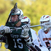 DAVID LE/Staff photo. Pentucket junior Ben Gardner (15) manages to get off a shot while taking a stick to the helmet against Ipswich in the D3 North Final on Friday evening. 6/10/16.