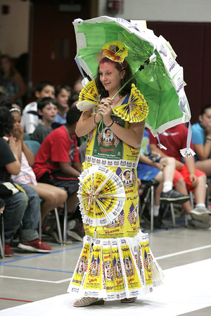 KEN YUSZKUS/Staff photo.      Sarah Dennis walks the runway at the Centerville School in Beverly. Fourth graders put on a fashion show to show off things they made out of recyclable materials.     06/15/16