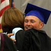 DAVID LE/Staff photo. Danvers graduate Mike Plansky hugs principal Susan Ambrozavitch after receiving his diploma. 6/11/16.