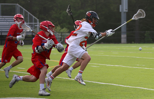 Beverly: During the North Division 2 playoff quarterfinal held at Endicott College on Saturday afternoon. Beverly beat Burlington 14-9. Beverly's Matt Carnevale, right, gets ahead of the Burlington pack, including Zachary Cyr, immediately at left. Photo by Allegra Boverman