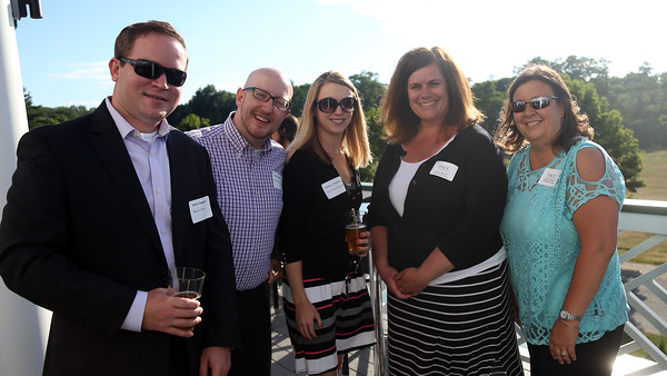 DAVID LE/Staff photo. Henry Haggart, Steve Spivey, and Ashley Lucchese, of Marriott, left, with Lauren Waelter and Donna Andrews, of Stonewood Tavern, right, at a multi-chamber after hours networking event held at the recently renovated Ferncroft Country Club in Middleton on Thursday afternoon. 6/30/16.