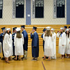 PAUL BILODEAU/Staff photo. Graduates wait in the gym before heading out to their ceremony during Hamilton-Wenham Regional High School's graduation ceremony in a tent on the football field at the school.