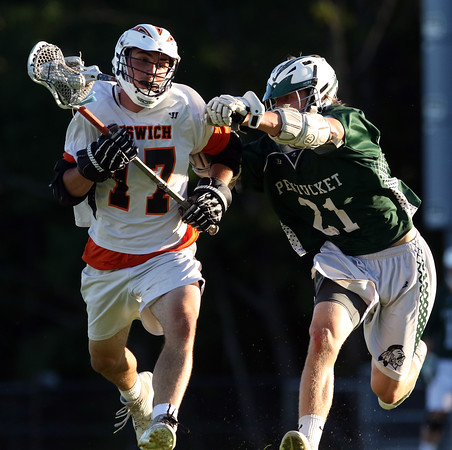 DAVID LE/Staff photo. Ipswich junior captain Charlie Gillis (17) gets checked by Pentucket junior Liam Sheehy (21) as he brings the ball into the zone. 6/10/16.