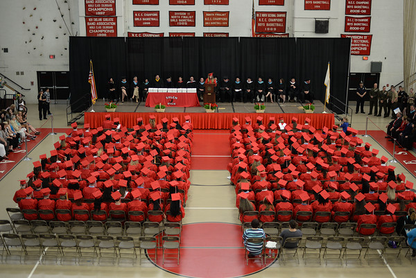 PAUL BILODEAU/Staff photo. Class president Victoria Kako delivers her address during Salem High School's graduation ceremony in the high school's field house.