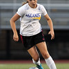 DAVID LE/Staff photo. Hamilton-Wenham's Maddie Berthoud carries the ball upfield for the South team against the North in the annual Agganis Classic Girls Soccer game. Berthoud scored one of the two South first half goals. 6/28/16.