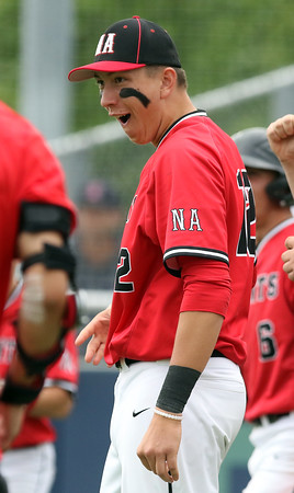 DAVID LE/Staff photo. North Andover senior Joseph Bramanti (12) reacts to teammate Joe Quinlan's solo homer off Danvers starter Dean Borders to cut the Falcons' lead in half.  6/9/16.