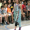 KEN YUSZKUS/Staff photo.      Samantha Swanick walks the runway at the Centerville School in Beverly. Fourth graders put on a fashion show to show off things they made out of recyclable materials.     06/15/16