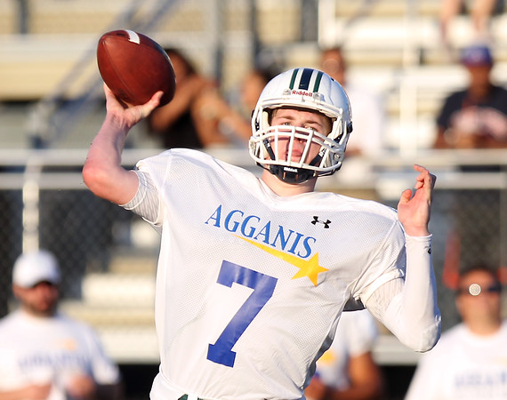 DAVID LE/Staff photo. Pingree quarterback Griffin Beal rifles a first down pass against the North in the 55th annual Agganis game. 6/30/16.
