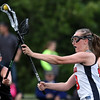DAVID LE/Staff photo. Marblehead sophomore Caroline Driscoll fires a shot past the outstretched stick of Ipswich sophomore Meghan O'Connor (12). 6/9/16.