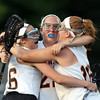 DAVID LE/Staff photo. Ipswich sophomore Grace Quinn, left, celebrates a Tigers' goal with juniors Delaney Whooley and Emma Moulton, right. 6/7/16.