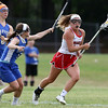 DAVID LE/Staff photo. Masco senior captain Molly Gillespie (11) sprints upfield while carrying the ball as Danvers senior captain Kristen McCarthy, left, tries to slow her down. 6/2/16.