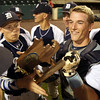 DAVID LE/Staff photo. Danvers juniors Jordan DeDonato, left, and Matt Andreas celebrate with the D2 North trophy. 6/11/16.