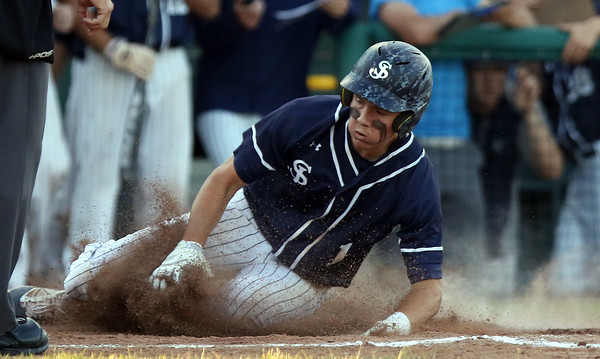 DAVID LE/Staff photo. St. John's Prep sophomore Michael Yarin slides safely across the plate with the Eagles' first run of the game against Braintree on Thursday evening. 6/16/16.
