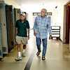 "KEN YUSZKUS/Staff photo.    Jim Terlizzi, left, and Bob Simons walk the hallways of the Higgins Middle School. They were both science teachers in the school when it was the high school during the late sixties. Like others, the public got to say ""goodbye"" to the old middle school on Monday.    06/27/16"