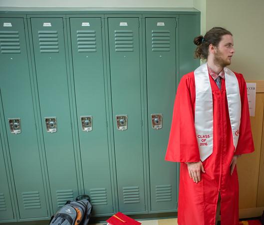 Kyle Zegel waits in the hallway for graduation ceremonies to start at Masconomet Regional High School graduation, Friday, June 3rd, 2016. JARED CHARNEY/Photo.<br /> June 3, 2016