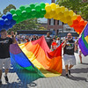 Carrying a jumbo Rainbow Flag onto the Salem Common under the Rainbow Arch are Ken Elie (l) and Ed Hurley (r) of the group Boston Pride, who turned out to support the North Shore Pride group.<br /> <br /> Photo by joebrownphotos.com
