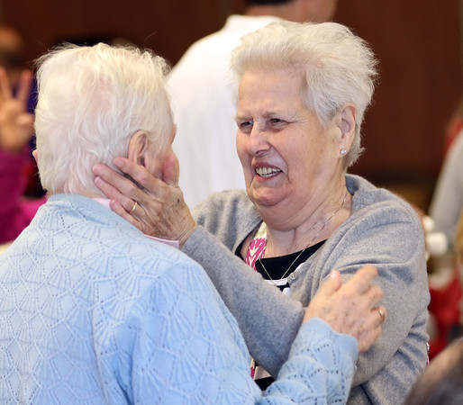 DAVID LE/Staff photo. Maureen Hastings, right, hugs and talks with Cecilia Gulhang, left, at a BBQ celebration held at the New England Homes for the Deaf in Danvers to commemorate their 115th year. 6/9/16.